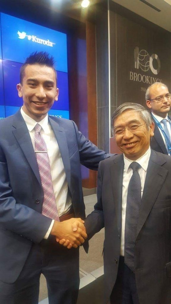 Khojinur Usmonov with Bank of Japan Governor Haruhiko Kuroda